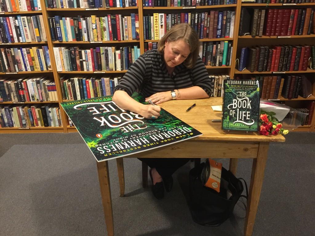 Deborah graciously signing the HUGE TBOL poster